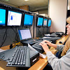 John P. Cleary | The Herald Bulletin<br /> Madison County senior PC technician Marsha Sharp works on setting up new computers with the updated Microsoft software for all the county's offices Thursday. Sharp sets up six units at a time and has done 150 computers so far with 100 more computers to replace.
