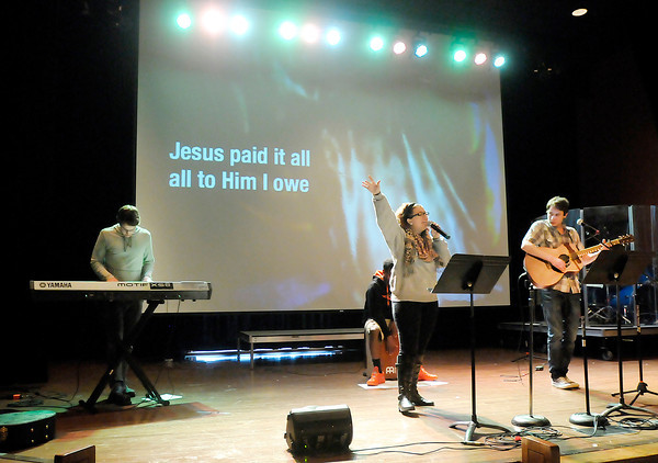 Don Knight | The Herald Bulletin<br /> Sam Westhoff, Damarcus Watkins, Abi Dawson and Ethan Utterback lead the worship during the Ignite service for high school students at Madison Park Church of God on Wednesday. Facing a $5.8 million balloon payment on a bond issued in 2007 the church entered bankruptcy to reorganize the debt and has now emerged from the proceeding.