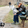 John P. Cleary | The Herald Bulletin<br /> James Blaylock reaches out for the leash as his dog BJ starts to wonder off as they take advantage of the spring-like weather to enjoy some time outside at Pulaski Park. Blaylock says he comes to the park almost everyday.