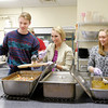 Don Knight | The Herald Bulletin<br /> From left, Anderson University students Ian Oechsle, Mallory Teskey and Kylie Kantner serve the evening meal at The Christian Center on Friday.