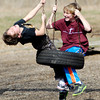 John P. Cleary | The Herald Bulletin<br /> Josiah Chris, 7, and Isaiah Grimsey, 8, laugh as they spin around on a tire-swing at Mounds State Park Monday afternoon enjoying the warmest day of the year.  The boys were at the park with their families who came from Hamilton County for the day for some spring-time fun in the park.