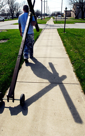 John P. Cleary | The Herald Bulletin<br /> Tim Hanshew carries a large cross around Anderson.