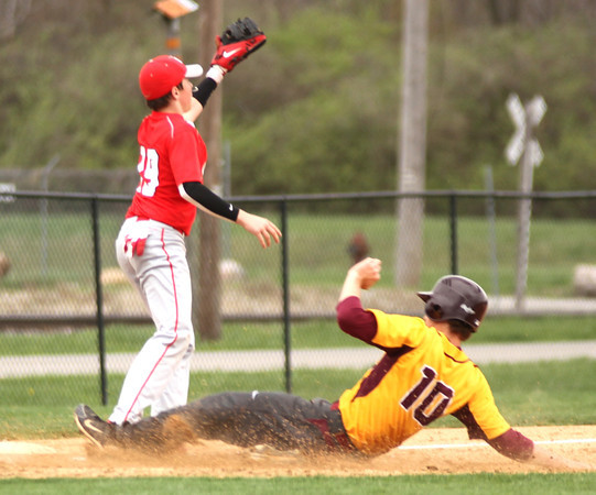 Photo by Chris Martin<br /> Alexandria's Jonah Jerrils slides safely into 3rd base Tuesday against Mississinewa