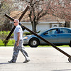 John P. Cleary | The Herald Bulletin<br /> Tim Hanshew, a member of Southdale Church of the Nazarene, carries this large wooden cross around Anderson neighborhoods throughout the year, here going along 53rd Street.