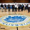 John P. Cleary | The Herald Bulletin<br /> The Geater Community Center held an open house Thursday afternoon to celebrate their remodeled facility and new gym floor.  Here city officials look over the large city emblem that adorns the center of the new gym floor after it was unveiled. To view or buy this photo and other Herald Bulletin photos, visit heraldbulletin.smugmug.com.