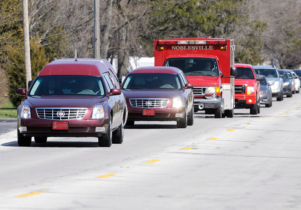 Don Knight | The Herald Bulletin<br /> The funeral procession for Jesse Sperry travels West on Indiana 32 towards Lapel and Brookside Cemetery on Wednesday. Sperry was killed in a traffic accident on April 6.
