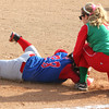Photo by Chris Martin<br /> Anderson's Alexandra Poor takes out Elwood's Haley Jetty after a rundown Thursday in the County Tournament