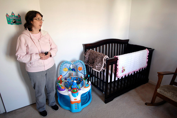 John P. Cleary | The Herald Bulletin<br /> Lisa Keefe, Rebecca Sperry's mother, looks over the nursery room for Autumn Marie that was redone for her in the Keefes' home were Rebecca and baby are now staying.