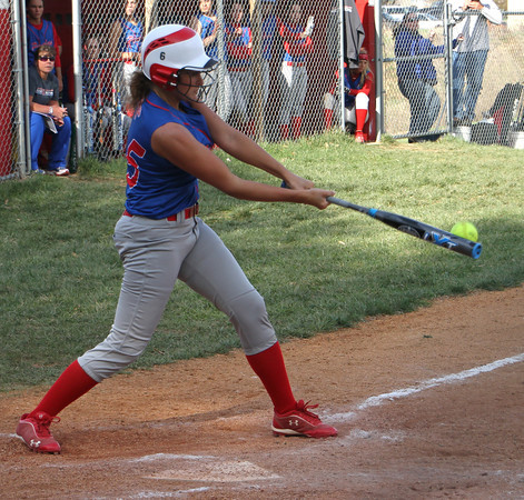 Photo by Chris Martin<br /> Elwood's Tenasha Stephens gets a hit against Anderson Thursday in the County Tourney
