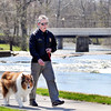 John P. Cleary | The Herald Bulletin<br /> Robert Jones, of Pendleton, takes advantage of the warm sunshine to get out and take his dog Harley for a walk along Fall Creek in Falls Park Thursday afternoon. The warming trend is forecast to continue through the weekend.