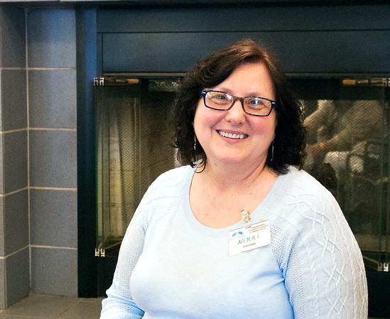 Danielle Grady | for The Herald Bulletin<br /> Nikki Staggs sits in front of a fireplace at Bethany Pointe Health Campus. Staggs has volunteered at Bethany Pointe for over three years.