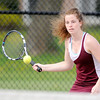 Don Knight   The Herald Bulletin<br /> Alexandria's Blaine Kelly returns a volley to Shenandoah's Kassidy Hook in the No. 1 singles match at Alexandria on Tuesday. The tigers won 4-1.