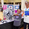 Amia White cheers on her Young Entrepreneur brother, Jordan, as he promotes his commercial endevour, HankySquared, during the Emerging Business Trade Show presented at the Union Building by the Madison County Chamber of Commerce.