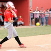 Don Knight | The Herald Bulletin<br /> Frankton's Ryann Shively connects on a double to score Sarah Stanley as the Eagles hosted the Anderson Indians on Wednesday.