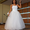 Debutante Jenae Davis graces the stage during the Debutante Cotillion/Beautillion Militaire Scholarship Ball on Saturday evening at Madison Park Church of God.