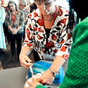 John P. Cleary | The Herald Bulletin<br /> Tersesa Holloway, left, administers a dose of Naloxone to a mannequin as <br /> Holly Renz RN, Community Hospital Anderson, explains the procedure during a demonstration of the life-saving drug at the Madison County Drug Addiction 2016 Summit held Thursday.