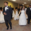 Participants in the Debutante Cotillion/Beautillion Militaire Scholarship Ball have a last minute rehearsal of their dance presentation.
