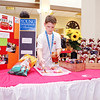 Jason Bale, President and CEO of Sweet J's Salsa, prepares samples of his product during the Emerging Business Trade Show presented at the Union Building by the Madison County Chamber of Commerce.