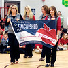 John P. Cleary | The Herald Bulletin<br /> Valley Grove Elementary School teachers come into the gym displaying the National Title I Distinguished School banner that the school won during a celebration Wednesday with State Superintendent of Public Instruction Glenda Ritz.
