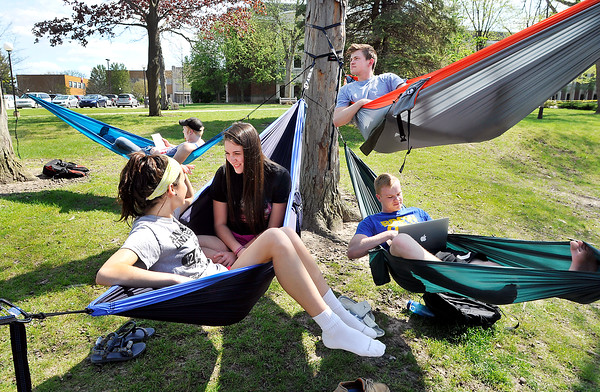 John P. Cleary | The Herald Bulletin<br /> These Anderson University students take advantage of the beautiful afternoon Monday to enjoy the campus valley in their hammocks. Maria Romeo and Charis Grubbs, front left, freshman; Adam Shuntich, back left, senior; and freshman Wes Davidson, upper right, and David Bailey soaked up the 80 degree sunshine.