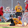Don Knight | The Herald Bulletin<br /> Alexandria's Isaac Granger slides safely into home on a wild pitch in the third place game between Alexandria and Anderson during the Nick Muller Memorial Baseball Tournament at Memorial Field on Saturday.