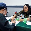John P. Cleary | The Herald Bulletin<br /> Dianna Lott, right, assistant director of admissions for Ivy Tech, assists  Imojene Williams with her application for the school during the Anderson Township Trustee Resource Fair held Friday at the Geater Center.