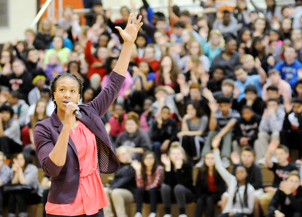 Don Knight | The Herald Bulletin<br /> WNBA superstar Tamika Catchings asks students to raise their hand if they want to go to college during a visit to Highland Middle School on Friday. Catchings told students to make a goal and work hard every day to reach it.