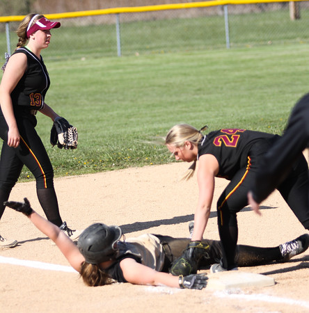 Chris Martin for The Herald Bulletin.  Madison Grant's Alie Carson slides safely into 3rd base Thursday against Alexandria in the County Tourney.