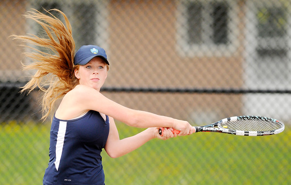 Don Knight   The Herald Bulletin<br /> Shenandoah's Kassidy Hook follows through on her backhand as she faced Blaine Kelly at Alexandria on Tuesday.