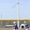 Don Knight | The Herald Bulletin<br /> Shenandoah's baseball team warms up with a jog in the outfield as the school's winder turbine can be seen in the background on Monday. Texas-based Calpine Corp. is seeking to develop a a 200-megawatt wind farm consisting of 80 to 100 wind turbines in northwestern Henry County.