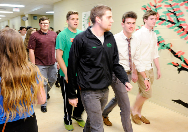 Don Knight | The Herald Bulletin<br /> Anderson High School's Academic Team follows the band as they play the school song and students line the hall on Tuesday. The team is competing in the finals of WTHR's Brain Game against North Central.