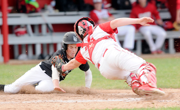 Don Knight   The Herald Bulletin<br /> Frankton's Connor Love tags Lapel's Satchell Wilson out during an attempt to steal home at Frankton on Friday.