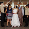 Debutante Jazmyun McCullough, accompanied by her parents, Danielle and Tony, walk through the arch of swords at the Debutante Cotillion/Beautillion Militaire Scholarship Ball on Saturday.