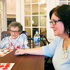 Danielle Grady | for The Herald Bulletin<br /> Nikki Staggs (front),  a Bethany Pointe Health Campus volunteer, stares at her bingo card, while Helen Voight (back), a Bethany Pointe resident, prepares to add another chip to hers.