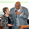 John P. Cleary | The Herald Bulletin<br /> Bobbette Snyder acknowledges Rev. Manual Hunt as she accepts a acknowledgement award from him for her husband Tom Snyder at the Anderson/Madison County Black Chamber of Commerce 2016 Corporate Luncheon.