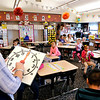 John P. Cleary |  The Herald Bulletin<br /> Students in Karen Griner's first-grade class at Valley Grove Elementary School work on telling time with hand-held clock faces.