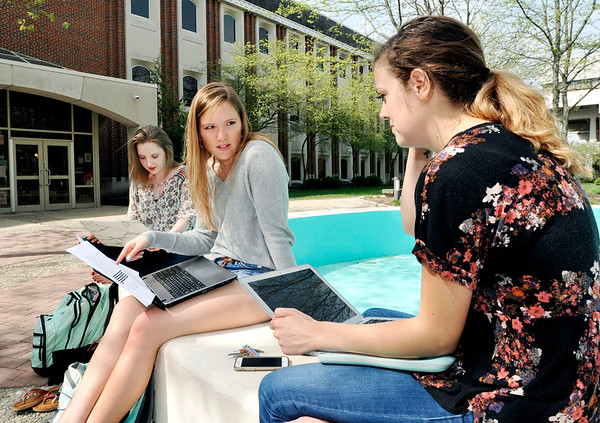 John P. Cleary    The Herald Bulletin<br /> Anderson University juniors Ellie McArdle, Bloomington, IN., Kadie Chrysler, Hilliard, OH., and Elise Strohl from Fishers, IN., take advantage of the warm spring weather to do some studying outside of Hartung Hall around Helios fountain.