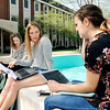 John P. Cleary |  The Herald Bulletin<br /> Anderson University juniors Ellie McArdle, Bloomington, IN., Kadie Chrysler, Hilliard, OH., and Elise Strohl from Fishers, IN., take advantage of the warm spring weather to do some studying outside of Hartung Hall around Helios fountain.