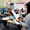 John P. Cleary |  The Herald Bulletin<br /> Highland Middle School sixth-grade teacher Joanne Maddox goes over the English lesson with her students Thursday.