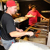Don Knight | The Herald Bulletin<br /> Greg Vannatta cooks tenderloins in his Pork Paradise food trailer during a fundraiser for Anderson firefighter Matt Gunter on Saturday.
