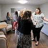 John P. Cleary |  The Herald Bulletin<br /> Libby Parker, left, executive director Beauty for Ashes, greets people during a open house Wednesday for their new education center.