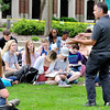 John P. Cleary    The Herald Bulletin<br /> Anderson University students take notes as professor Brian Dirck conduces his  American history class this past Wednesday outside in the valley.