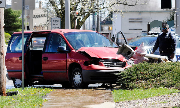 Don Knight | The Herald Bulletin<br /> According to APD the driver of this red minivan ran a red light hitting a Monte Carlo before hitting a fire hydrant at 11th and Brown-Delaware on Friday.