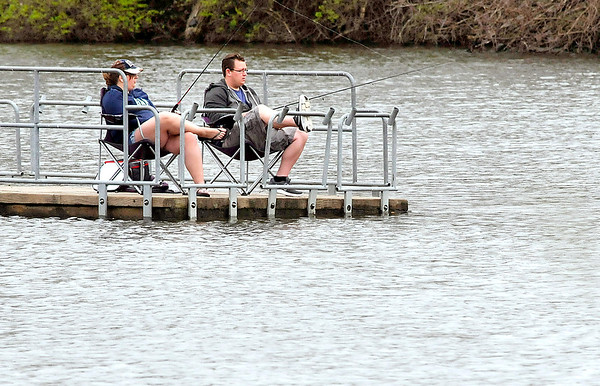 John P. Cleary |  The Herald Bulletin<br /> Bethany Bratton and Joe Kelley, both of Anderson, enjoy the day fishing off the end of the Shadyside Lake pier Monday as the recent rains have raised the water level to just below the pier deck.