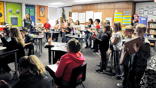John P. Cleary |  The Herald Bulletin<br /> Fourth-graders from Summitville Elementary School tour Park Elementary School as part of a proposed realignment of schools. Here Park Elementary School Principal Emily K. Tracy shows the students one of their classrooms where they have new style desks for the students.