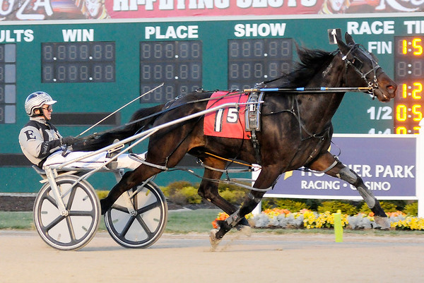 Don Knight | The Herald Bulletin<br /> Undertaker driven by Don Eash wins the fifth race on opening night of the live racing season at Hoosier Park on Saturday.