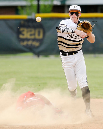 Don Knight | The Herald Bulletin<br /> Daleville's T.J. Price completes a double play as the Broncos hosted Frankton on Wednesday.