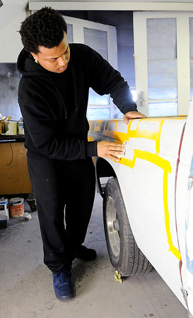Don Knight | The Herald Bulletin<br /> Collision repair student Tobias Brisker sands a coat of primer at D26 on Thursday.