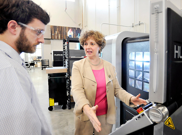 John P. Cleary    The Herald Bulletin<br /> Matt Blessing, lab manager for Makerspace in Purdue Polytechnic Institute, answers Rep. Susan Brooks question as he shows her the operation of a metal CNC mill/lathe machine as she tours the facility Monday.