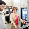 John P. Cleary |  The Herald Bulletin<br /> Matt Blessing, lab manager for Makerspace in Purdue Polytechnic Institute, answers Rep. Susan Brooks question as he shows her the operation of a metal CNC mill/lathe machine as she tours the facility Monday.